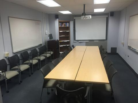 [photo of LRC showing table for work area and projection screen]